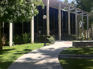 Photograph of the pillared entrance into Van Nuhys Branch Library, Van Nuhys California