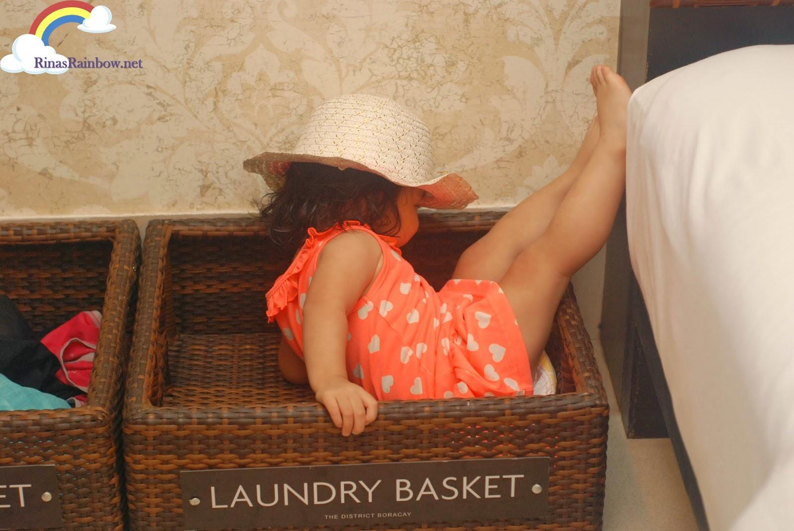 toddler in basket