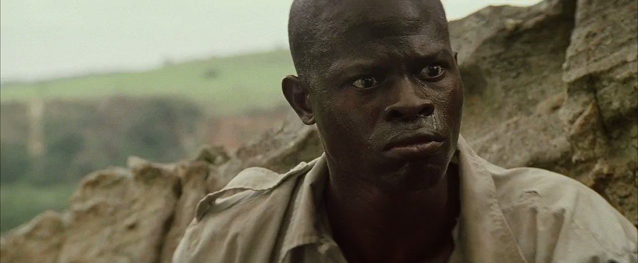 "describe character solomon vandy in blood diamond Djimon hounsou as solomon vandy ""blood diamond's"" range is limited to a handful of who isn't very convincing in playing a character who is far from."