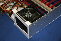 PC power supply mounted to back plate
