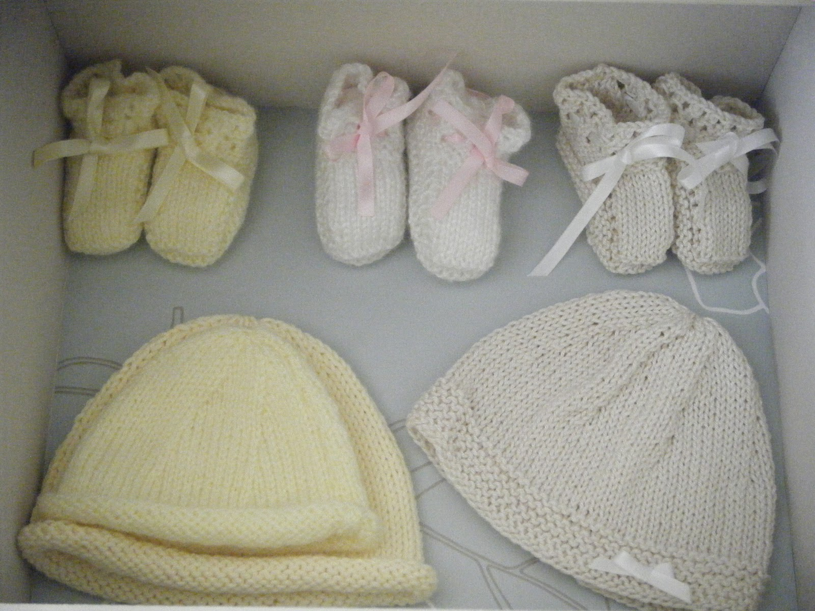 Hand knitted baby booties and hats