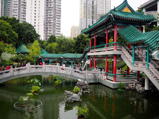 Traditional Chinese architecture of pavilion & bridge on the pond in the garden of Sik Sik Yuen Wong Tai Sin Temple, Hong Kong