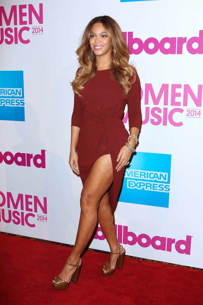 Beyonce flaunts curves at the 2014 Billboard Women in Music Luncheon in NYC