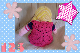 crochet a doll with a removable circular vest and yarn fishtail braids