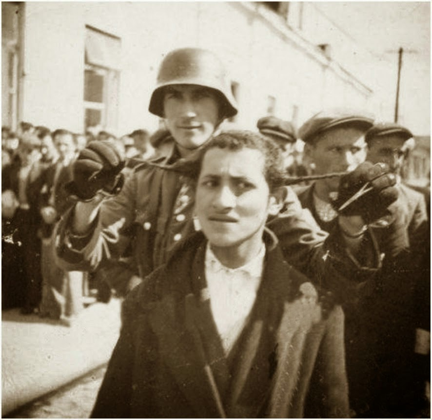 German Soldier, Mocking Jewish Prisoner.
