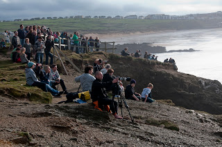Crowded beaches in Cornwall watch big wave surfing