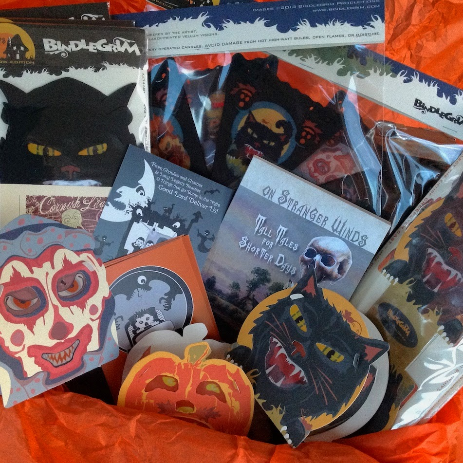 Limited edition paper goods in a vintage-style by Bindlegrim feature cats, pumpkins, jack o'lanterns, witches, devils, and scarecrows, on decorations for Halloween