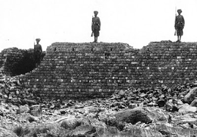 1800s photo of three Sikh guards atop a wall
