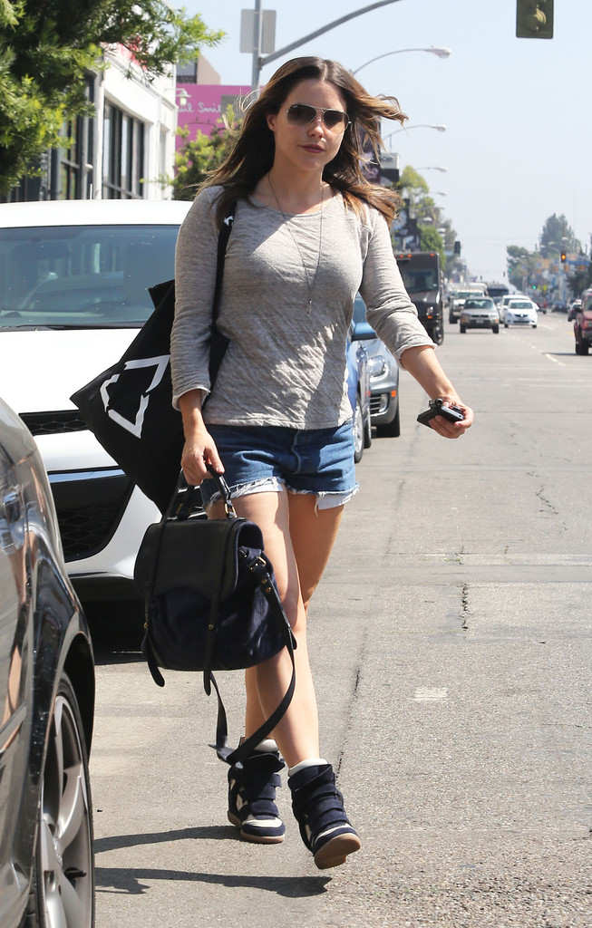 Sophia bush walking down the street