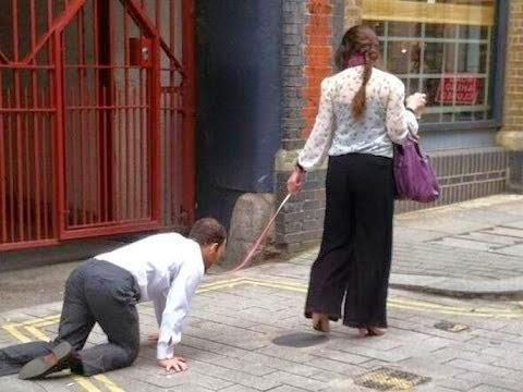 بالفيديو: امرأة تجرّ رجلاً بسلسلة في شوارع لندن...لا حول و لا قوة الا بالله !!!