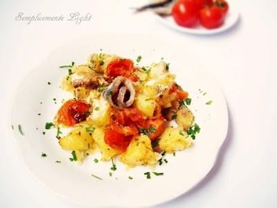 Tortino di patate,pomodorini e acciughe