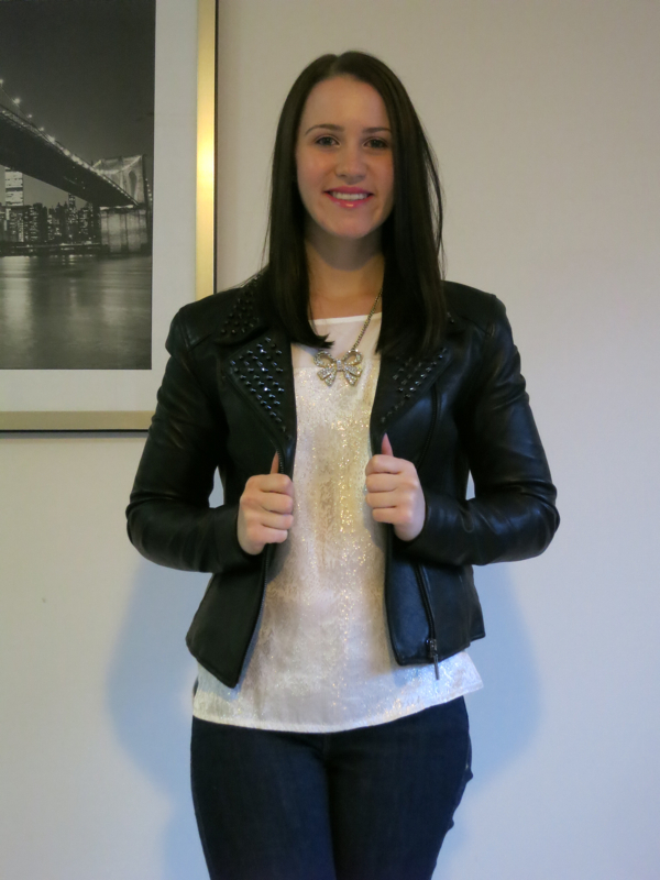 petite outfit, petite nighttime outfit, black leather studded jacket, cream sparkly top, jeans, booties, sparkly bow necklace