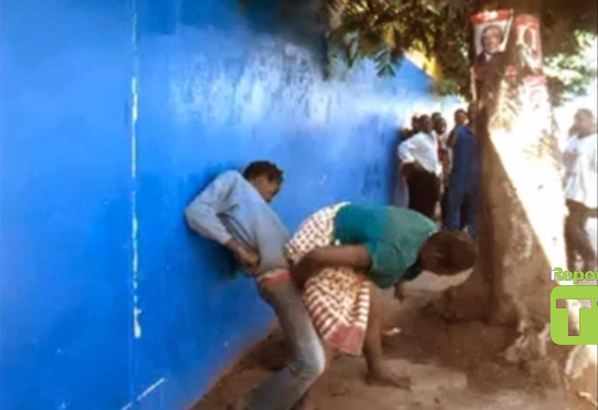 naijauncut com mad man and mad woman fucking in public in ghana