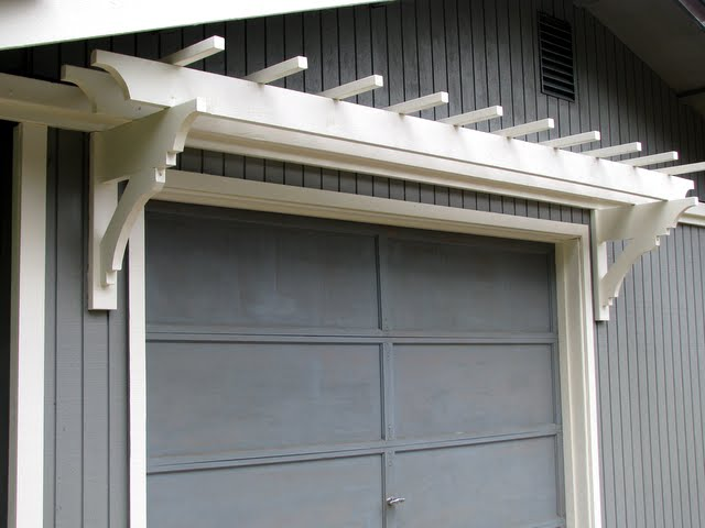 Blue roof cabin diy trellis over the garage door