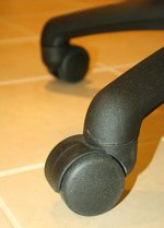 Caster wheels on a chair.