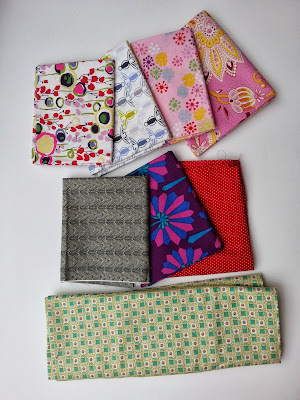 folded fabrics in an array of patterns and colors