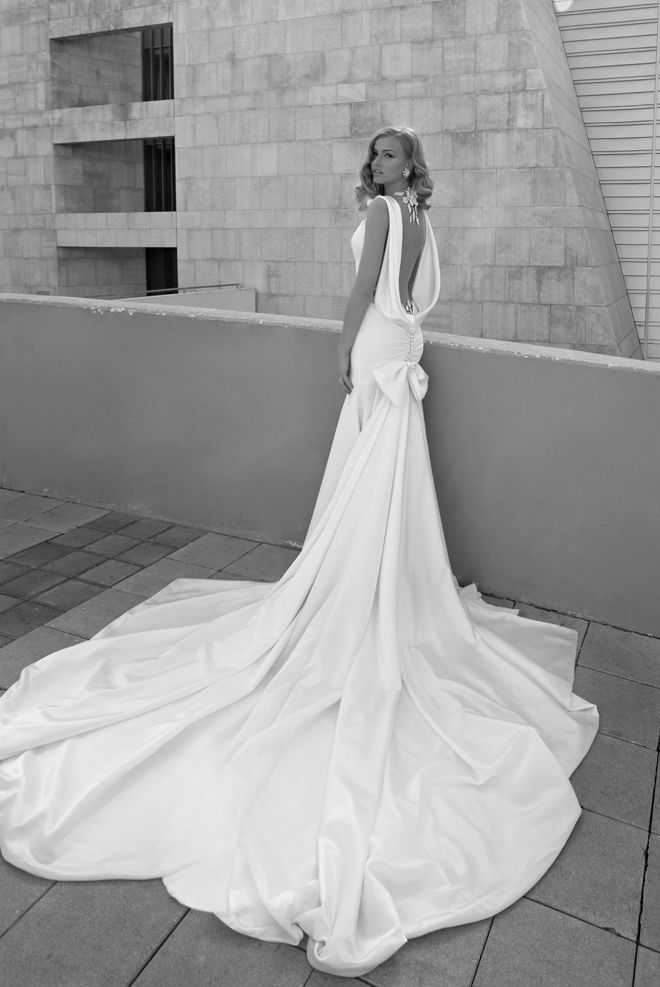 Extra long white wedding dress with white gold necklace