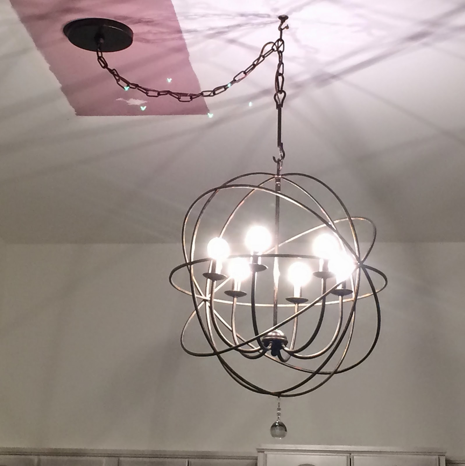 librarian tells all the orb chandelier from ballard designs it was almost painful to look directly at the chandelier the next day we put in 60 watt bulbs with frosted glass the light is brighter but much gentler