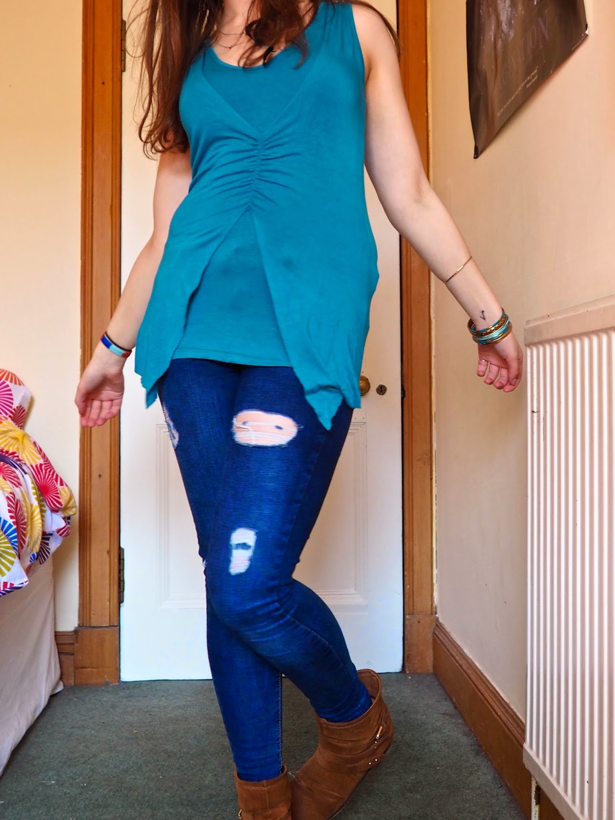 Blue Jeans outfit   Blue layered vest top, ripped skinny jeans, brown ankle boots