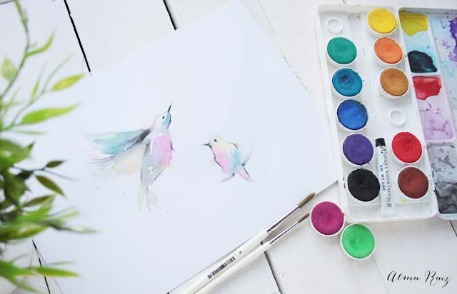 Pájaros pintados con acuarela