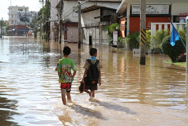 Kids on a flooded Dibuk Road in Phuket Town, 22nd August 2012