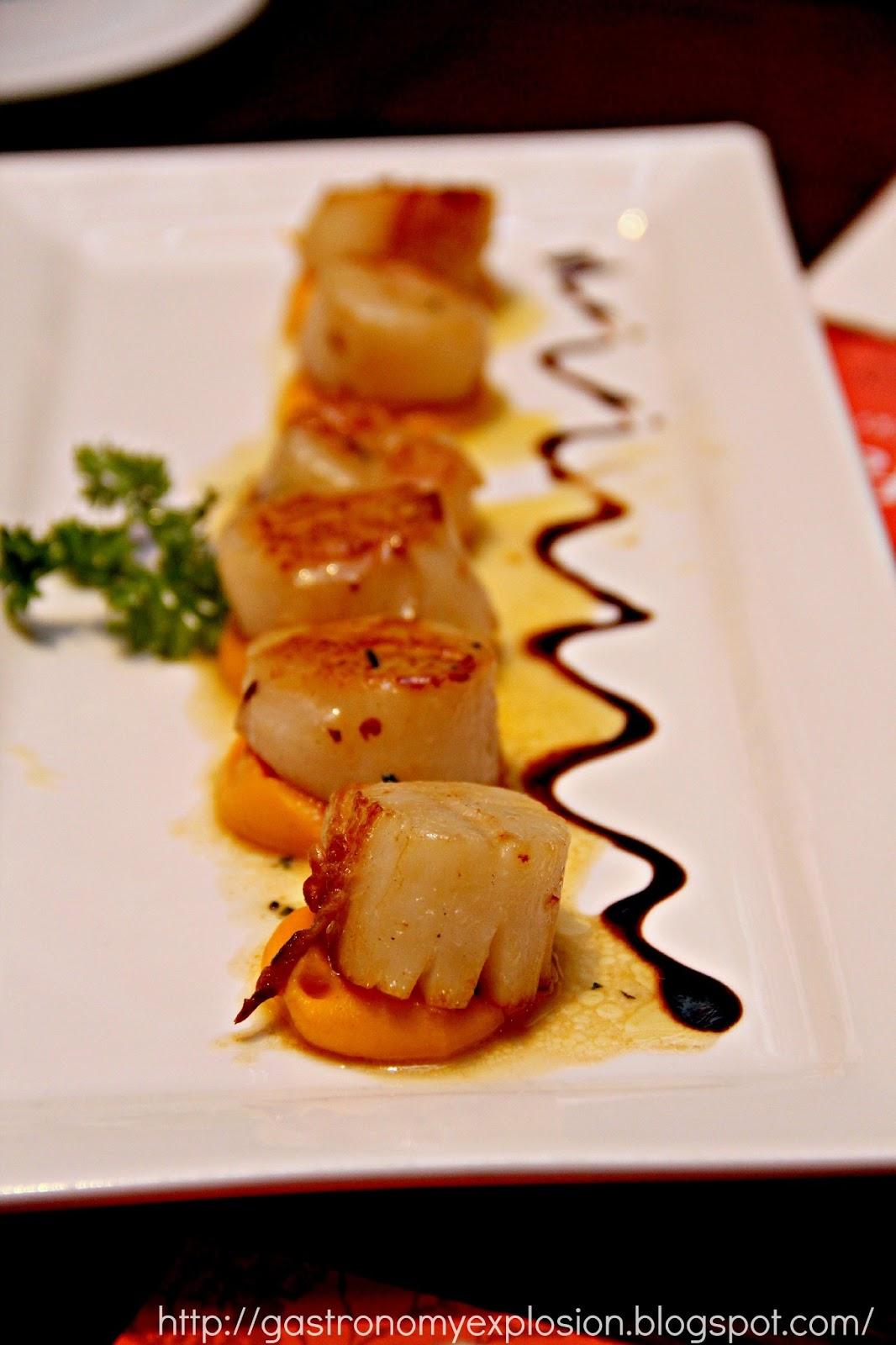 ... juicy seared sea scallops on sweet potato puree and tarragon butter