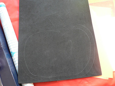draw a pumpkin shape on black craft foam