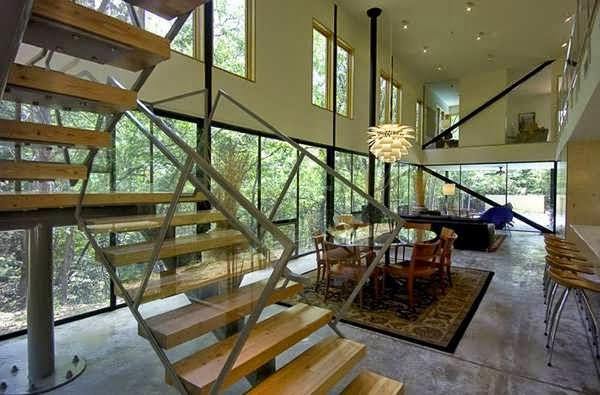 Narrow lot house design occupies a wooded area flanked for Contemporary houses in dallas for sale