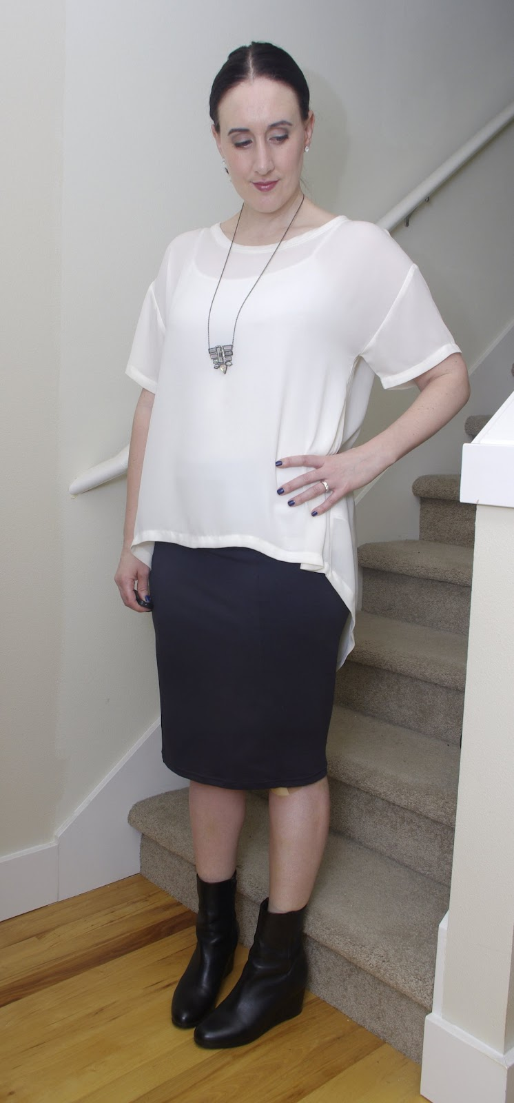 Leith fitted grey tube skirt and cream high-low tee, Vince low wedge booties in black, Alexis Bittar bib pendant necklace