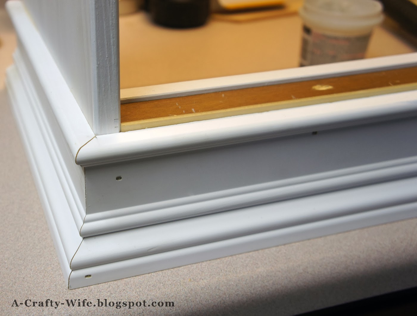 Decorative baseboards adds a polished look to Ikea Rast hack base | A Crafty Wife