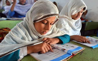 little girl studying in Pakistan