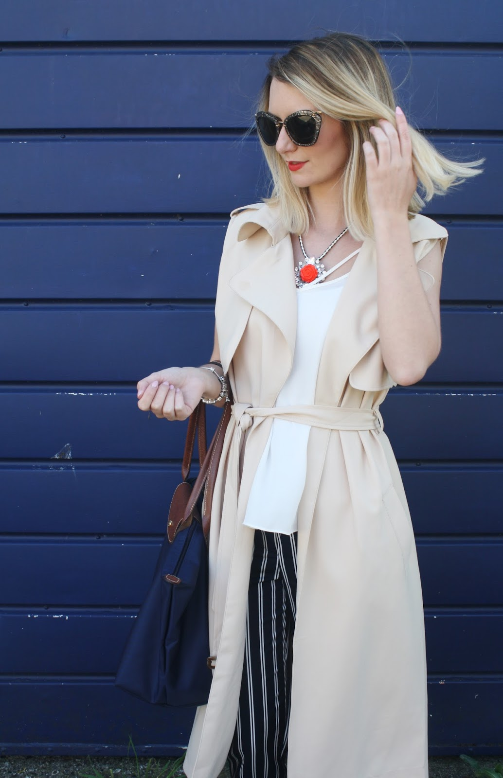 Pinstripe navy trousers and camel trench coat