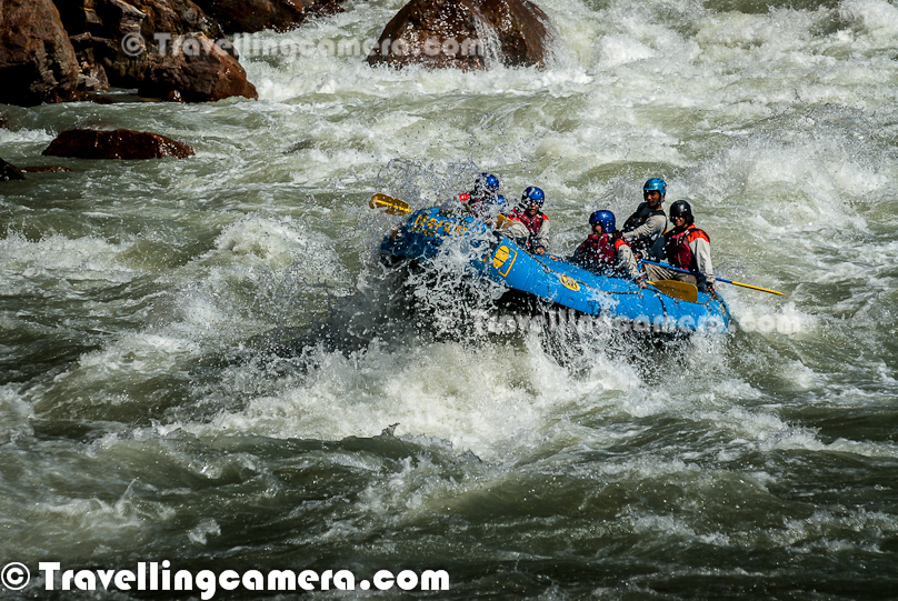 Rafting or white water rafting is one of the challenging recreational outdoor activity using an inflatable raft to navigate a river or other bodies of water having different levels of water-current. This is usually done on white water or different degrees of rough water, in order to thrill and excite the raft passengers. Rafting is considered an extreme sport, as it can be dangerous as times. This Photo Journey shares some of the photographs of Rafting in Risikesh, which is one of the popular places in India to do White Water Rafting.Recently we were in Rishikesh with office friends and Rafting was one of the top item in our list of things we wanted to do. We started in bus from Aspen Camps in Rishikesh and then boarded to jeeps with rafts. We had to start from Marine Drive which is a huge Ganges beach with enough space for folks to prepare and get started. Marine Drive is a place, strategically identified to start Rafting. Shivpuri is another preferred place to start Rafting. Idea is to make people comfortable with various types of water-rapids and then gradually start enjoying various stretches in river. Ganges provides a good range of water rapids and makes rafting an unmatchable experience.Rishieksh is one of the main places to do rafting in North India. Long time back I had done rafting in Vyas River near Kullu and that time all other rafters were professionals and I was covering a particular camp for Tourism Development program. Since I was not much involved in rafting activities, I couldn't enjoy it much that time. At Rishikesh, we had a wonderful coach/leader, who made rafting experience as great fun.After reaching Marine Drive Ganges beach, everyone of us got life jackets, a pedal and helmet. All three important things were with us and coach told us the best ways of using these three. All set with tight life-jacket, well settled helmet and appropriately gripped pedals we stepped into the raft after cleaning our feet in ganges water. It's recommended not to bring sand particles inside the raft, which can harm later. The coach threw chilling ganges water on us to start the journey in chilled water of ganges with different current levels. Coach with one of other Rafting professional entered into the raft. Then he briefed everyone of us about different commands like fast forward, move backward, stop etc. Initially it was difficult for us to gram every details of each command, but every command was very important for best rafting experience.Apart from basic Rafting commands, coach/leader also tells about basic rules of White Water Rafting. He also understands about each person sitting in the raft about their past experience with water. He also shares some basic steps for people who are not comfortable while sitting in raft. Of course, there are some standard rules to sit on a raft and make yourself comfortable even when body needs to stick with raft through feet in a particpular position. The Thumb rule is to listen your coach and follow him without any alternation, even in difficult situation. Idea is to trust the coach/Leader and follow his/her commands with any panic.So we started with baby steps and raft started moving towards Rishikesh (Lakshman Jhoola). For first 10 minutes, we were really slow and it was more of practice session, wehere coach was making us prepared for following his commands throughout the whole stretch we had to do in river. After practicing all the commands and moving our raft in circle, coach/leader asked us to stand on boundaries of raft and balance with pedal mounted on raft top. None of us could gather courage to stand on the boundaries and negotiated with coach/leader to stand inside the raft and try to balance with pedals. It was one of the major test for us and raft moves a lot. Many times, some of us stumbled and others were getting impacted because of imbalance. This task completed and coach/leader asked us to move forward.First we encountered Good Morning Rapid which is the beginning of Rafting experience. Good Morning rapid always come of the way and it doesn't matter that what was your starting point :). It was very basic but yet exciting because of first encounter with relatively fast flow of water-waves. Before hitting the rapid, some of the screaming while others were laughing to hide the fear :)All these photograph in this Photo Journey are clicked day before we did rafting. One day before we did rafting, we kept going to different places around river bed to shoot rafts sailing through high rapids of Ganges white water. Above photograph shows one of the raft getting up side down at Golf Course. One of the other leader jumped into the water to rescue raft and then every rafter. Within 5-8 minutes everyone was back on top of raft and moved forward towards Laxman Jhoola, which was end point. In such situations, ideally, everyone should listen carefully to what leader says and follow with panic. Things can get worse in case of avoidance of leader commands.The modern rafts are inflatable boats, consisting of very durable, multi-layered rubberized (hypalon) or vinyl fabrics (PVC) with several independent air chambers. The length varies between 3.5 meters and 6 meters, the width between 1.8 meters and 2.5 meters. The exception to this size rule is usually the packraft, which is designed as a portable single-person raft and may be as small as 1.5 metres long and weigh as little as 1.8 kilograms.Rafts come in a few different forms. In Europe and Australasia, the most common is the symmetrical raft steered with a paddle at the stern. Other types are the asymmetrical, rudder-controlled raft and the symmetrical raft with central helm (oars) or Stern Mounts with the oar frame located at the rear of the raft. Rafts are usually propelled with ordinary paddles and or oars and typically hold 4 to 12 persons. In Russia, rafts are often hand made and are often a catamaran style with two inflatable tubes attached to a frame. Pairs of paddlers navigate on these rafts. Catamaran style rafts have become popular in the western United States as well, but are typically rowed instead of paddled.Check out more at - http://en.wikipedia.org/wiki/RaftingAfter Good-Morning rapid, we crossed - Black Money, Three Blind Miles, Cross Fire, Shivpuri, Return to center, Roller Coaster, Tea off, Golf Course, Club House, Initiation, Body Surfing, maggie point & Cliff jumping, Double Trouble, Hilton and fianally Ram Jhoola. I went till Golf Course only and most of the other rafts from our group ended at Lakshman Jhoola.The most suitable time for River Rafting in Rishikesh is from September to November and from March to April-May. One of the best rivers in the world to experience the sheer exhilaration of white water rafting, it is the sheer invincible power of the Ganga river that often attracts the adventurer to the challenging sport of river rafting at Rishikesh.Generally White Water Rapids are divided into 6 levels of difficulty.Grade 1: Very small rough areas, might require slight maneuvering. (Skill Level required is very BasicGrade 2: Some rough water, maybe some rocks, might require some maneuvering. (Skill level: basic paddling skillGrade 3: Whitewater, small waves, maybe a small drop, but no considerable danger. May require significant maneuvering. (Skill level: experienced paddling skills)Grade 4: Whitewater, medium waves, maybe rocks, maybe a considerable drop, sharp maneuvers may be needed. (Skill level: whitewater experi\\Grade 5: Whitewater, large waves, large volume, possibility of large rocks and hazards, possibility of a large drop, requires precise maneuvering. (Skill level: advanced whitewater experience)Grade 6: Class 6 rapids are considered to be so dangerous that they are effectively unnavigable on a reliably safe basis. Rafters can expect to encounter substantial whitewater, huge waves, huge rocks and hazards, and/or substantial drops that will impart severe impacts beyond the structural capacities and impact ratings of almost all rafting equipment. Traversing a Class 6 rapid has a dramatically increased likelihood of ending in serious injury or death compared to lesser classes. (Skill level: successful completion of a Class 6 rapid without serious injury or death is widely considered to be a matter of great luck or extreme skill and is considered by some as a suicidal venture)In Rishikesh, we have crossed rapids of Level-3 difficulty as max. But it was great fun to face level three rapids. Water comes on to your body and pushes back and sometimes people get down into the water due to thrust.White water rafting can be a dangerous sport at times, especially if basic safety precautions are not observed. Both commercial and private trips have seen their share of injuries and fatalities, though private travel has typically been associated with greater risk. Depending on the area, safety regulations covering raft operators may exist in legislation. These range from certification of outfitters, rafts, and raft leaders, to more stringent regulations about equipment and procedures. It is generally advisable to discuss safety measures with a rafting operator before signing on for a trip. The equipment used and the qualifications of the company and raft guides are essential information to be considered.Like most outdoor sports, rafting in general has become safer over the years. Expertise in the sport has increased, and equipment has become more specialized and increased in quality. As a result the difficulty rating of most river runs has changed.
