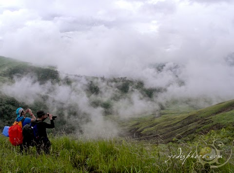 Two mountaineers capturing the beauty of clouds at Mt. Cinco Picos hover_share