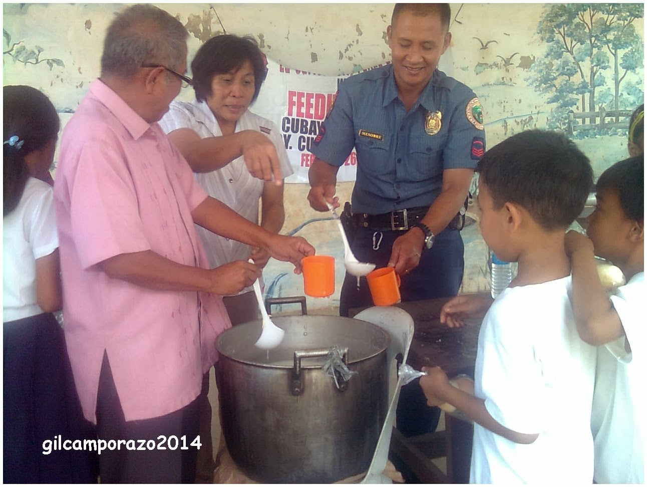 Sir Camporazo assisting in feeding the pupils with his teacher