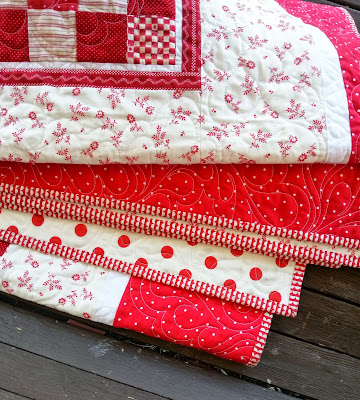 a close up detail picture of the quilting and binding on an all red quilt