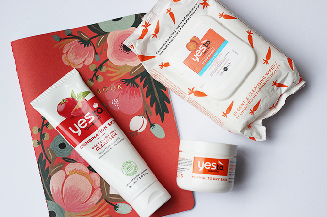 A photo of Yes to Carrots and Yes to Tomatoes cleanser, moisturiser and face wipes
