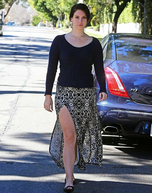 Talk about bringing a good temperature, Lana Del Rey, 29, is certainly a pro at working.  The singer displayed her amazing beauty legs in a Maxi Dress as she walked alone at the street in Los Angeles on Friday, January 23, 2015.