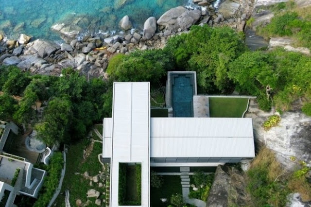 Photo of an amazing home as seen from the air right above the house