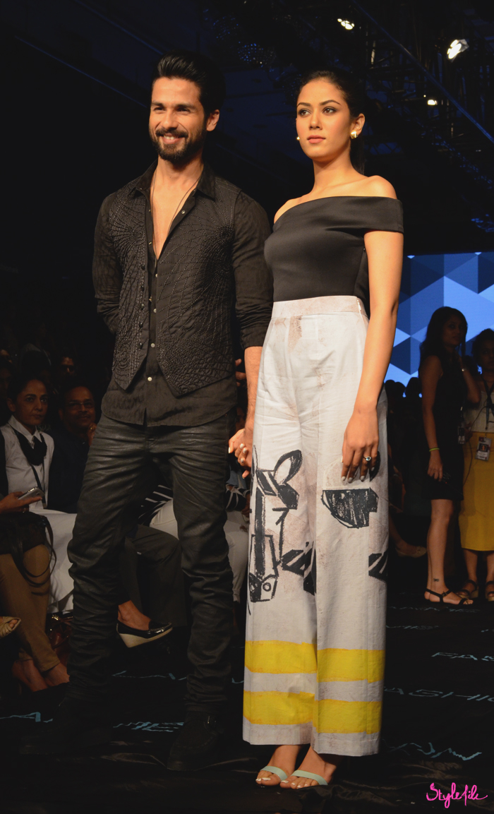 Bollywood actor Shahid Kapoor and his wife Mira Rajput pose for photographers before the show of Masaba Gupta at Lakme Fashion Week Winter Festive 2015 at the St. Regis Hotel