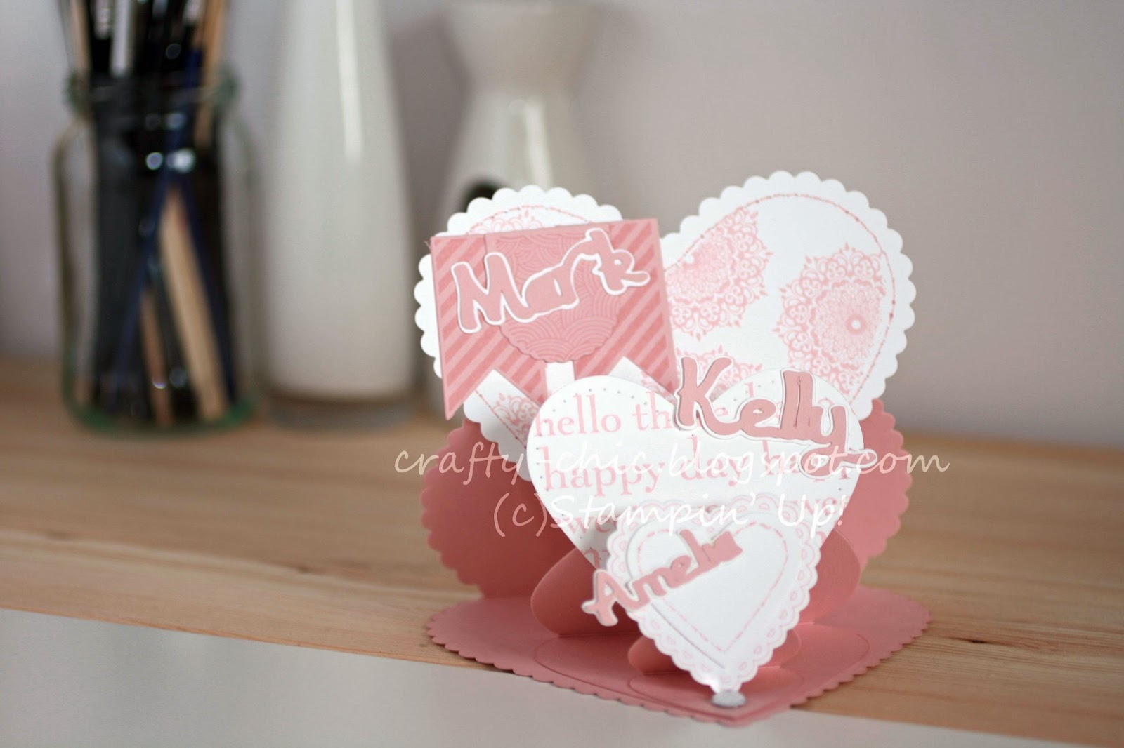 A triple easel card made from the Stampin' Up heart framelits