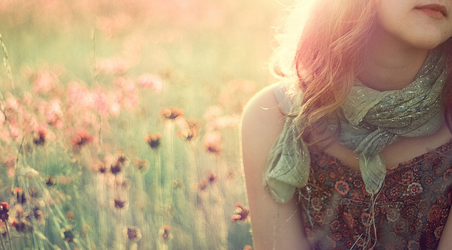 girl in field of wild flowers