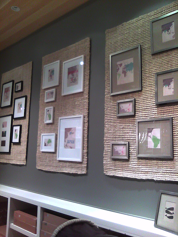 Those are jute rugs that were nailed to the wall, with the framed pictures  hung over them. I think this is a really cool way to do a gallery wall.