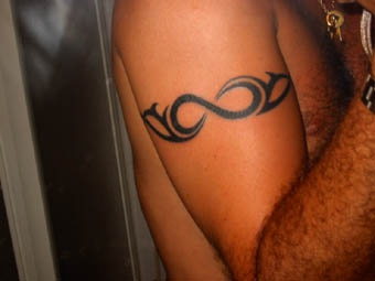 Shoulder tribal tattoo with infinity symbol