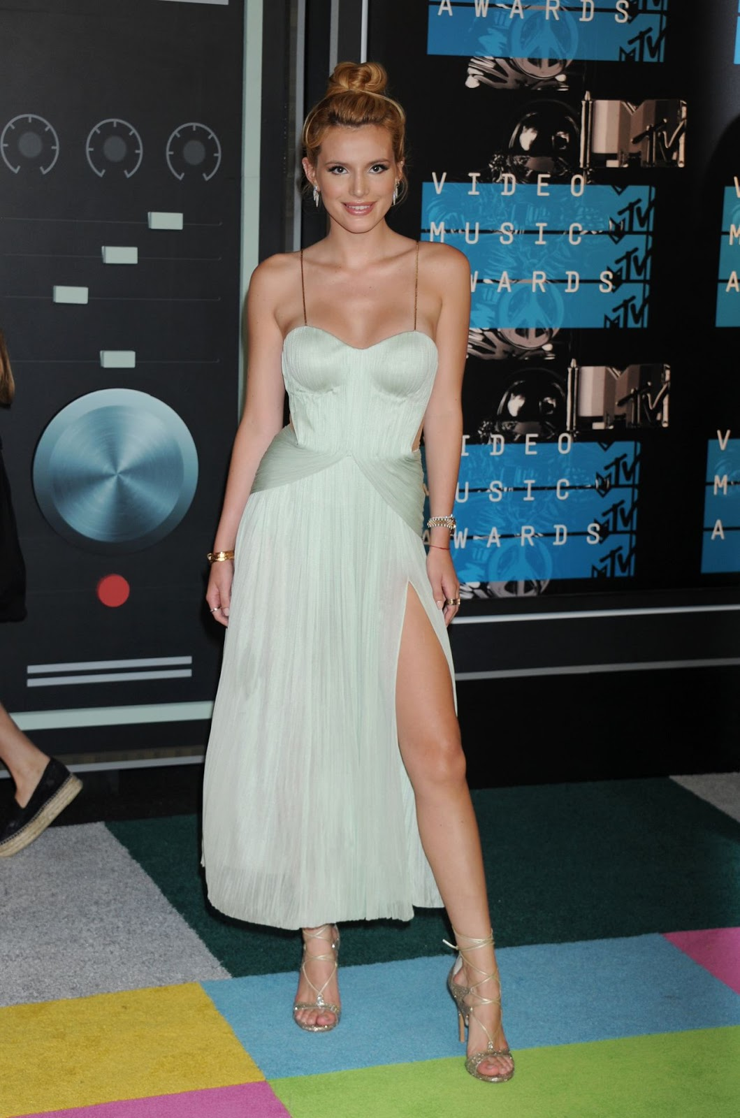 Bella Thorne shines in mint green and topknot at the VMA's 2015