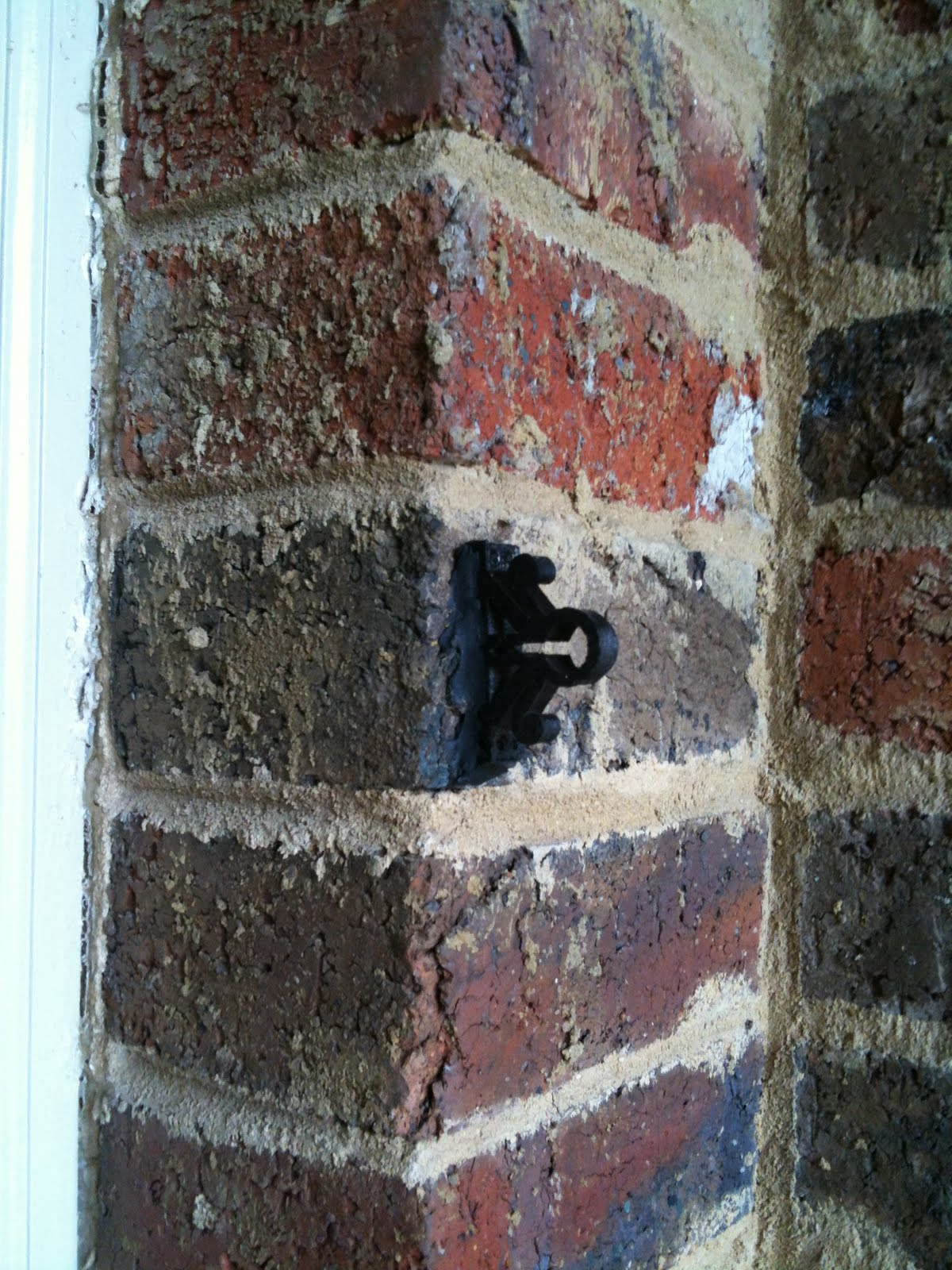 a clip attached to the brick with sugru