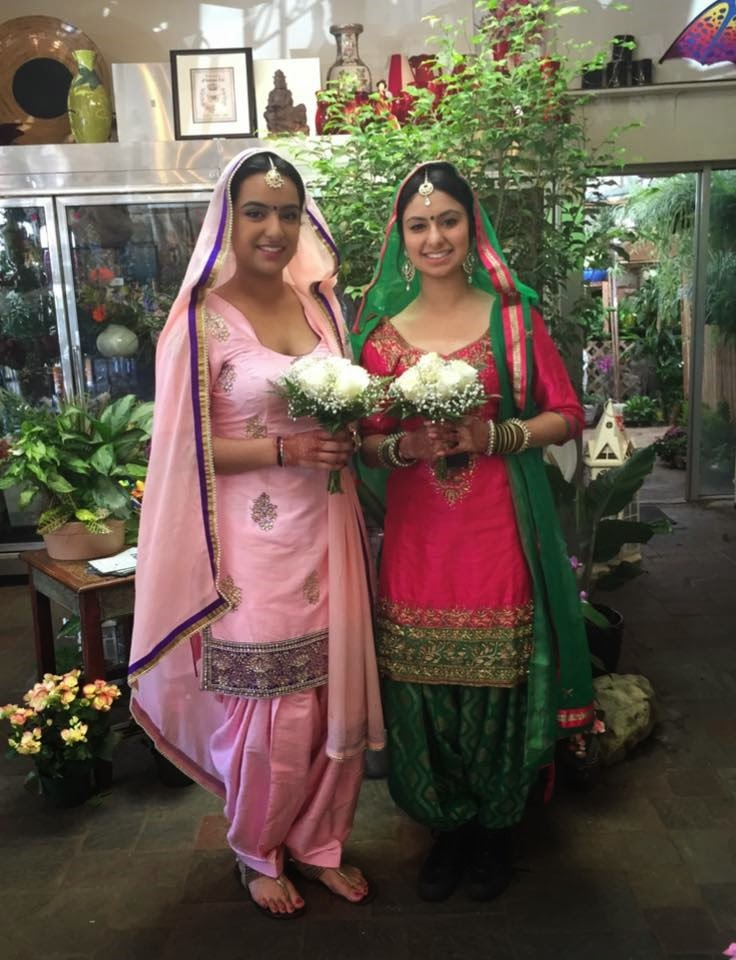 Bridesmaids of a traditional Indian Wedding with flowers by Stein Your Florist Co.