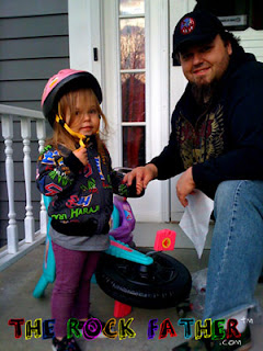 Father daughter big wheel