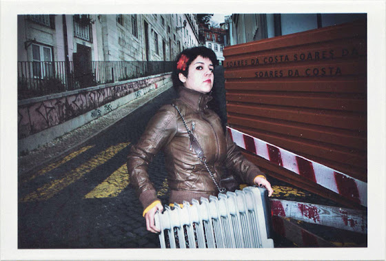 dirty photos - Once - street photo of girl carrying a heater in lisboa