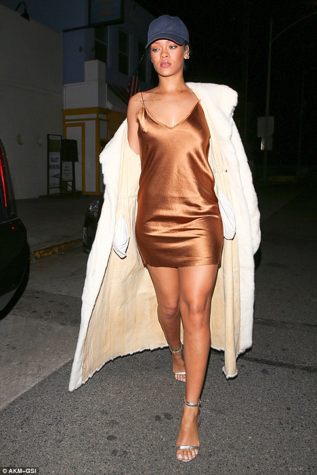 Rihanna went braless, but attempted to cover up her look with a long fur coat